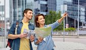 travel, tourism and vacation concept - happy couple of tourists with city guide, map and backpacks o poster