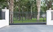 Metal Driveway Rural Property Entrance Gates Set In Brick Fence With Lights And Eucalyptus Gum Trees poster