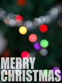 picture of merry christmas text  - A Christmas abstract with copy space and a blurred holiday image in the background - JPG
