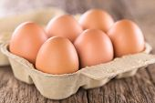 Raw Brown Eggs In Egg Box Or Carton (very Shallow Depth Of Field, Focus On The Front Of The First Eg poster