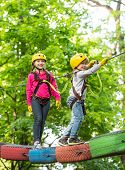 Small Boy Enjoy Childhood Years. Happy Child Boy Calling While Climbing High Tree And Ropes. Cute Ch poster