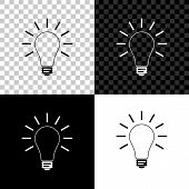 Light Bulb With Rays Shine Icon Isolated On Black, White And Transparent Background. Energy And Idea poster