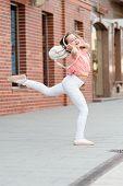 Best Street Dancing Ever. Energetic Little Girl Dancing With Pleasure. Listening Dancing Music. Ador poster