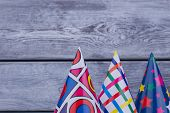 Birthday Party Caps With Copy Space. Festive Paper Caps On Wooden Background With Text Space. poster