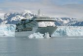 stock photo of cruise ship  - Cruise Ship passing by iceberg at glacier bay in Alaska - JPG