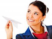 foto of air hostess  - Air hostess holding a paper airplane  - JPG