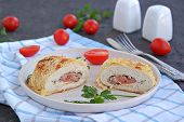 Homemade Fillet Cordon Bleu Or Chicken Fillet With Ham And Cheese On A White Clay Plate On A Dark Br poster