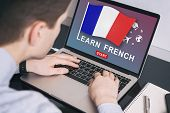 Man Working On Laptop With Learn French On A Screen. Education Learning French Language School Conce poster