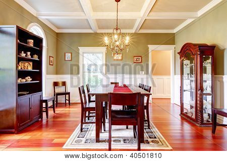 Luxury Elegant Green Dining Room With Cherry Floor.