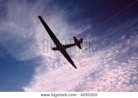 Glider against a beautiful sky at sunset