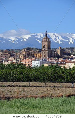 Town and Sierra Nevada Mountains, Guadix, Andalusia.