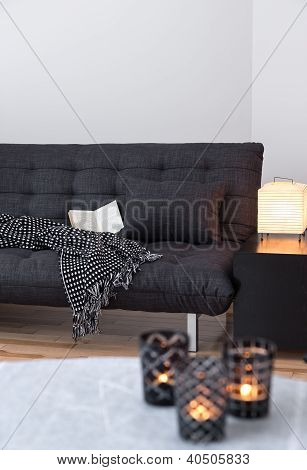 Gray Sofa And Cozy Lights In The Living Room