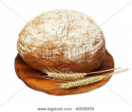 Traditional Rye Bread And Wheat On A Wooden Board