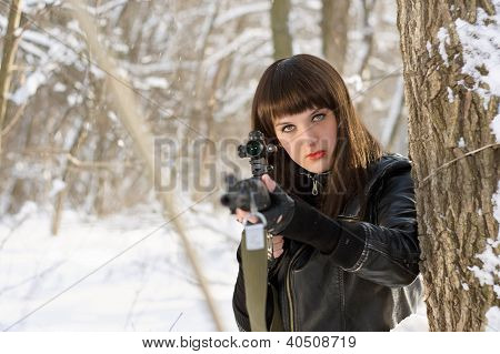 Sexy Young Woman With A Sniper Rifle