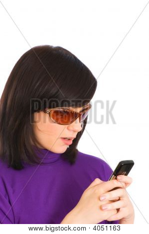 Close Up Of Young Woman Sending Sms