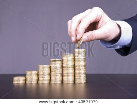 Hand Stacking Coins