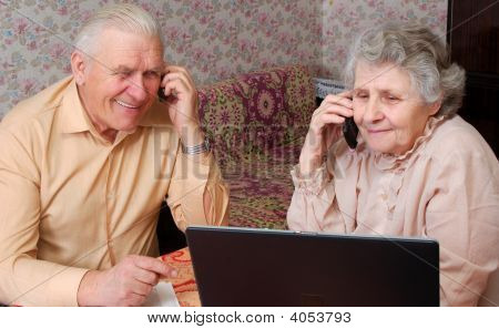 Senior Couple Gossip About Something By Phone