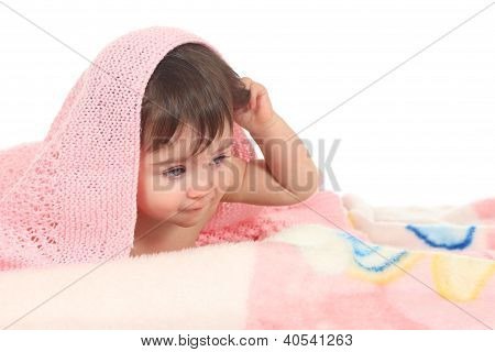 Tired Baby Under A Pink Blanket