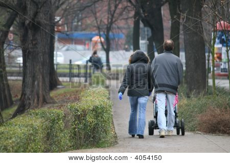 Couple On A Walk With A Child
