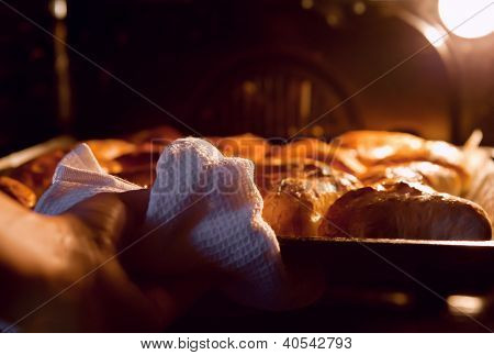 Woman Hand Taken Out Apple Pies From The Oven