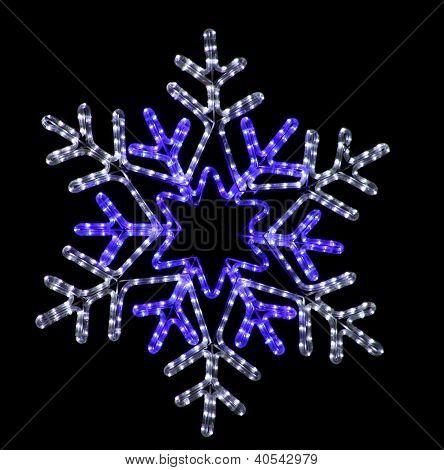 Festive Snowflake Street Light Decoration on Black Background