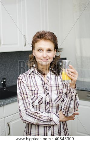 A Woman With An Orange Juice