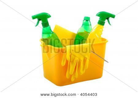 Green And Chemical Cleaning Products Together In A Bucket