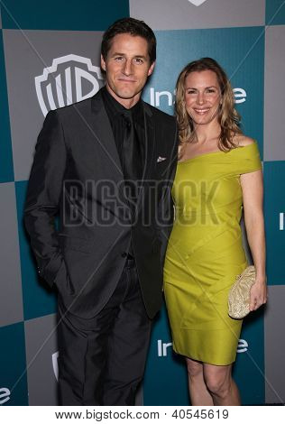 LOS ANGELES - JAN 15:  Sam Jaeger & wife Amber arriving to Golden Globes 2012 After Party: WB / In Style  on January 15, 2012 in Beverly Hills, CA
