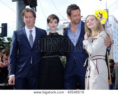 LOS ANGELES - DEC 12:  Tom Hooper, Anne Hathaway, Hugh Jackman & Amanda Seyfried  arriving to Walk of Fame Honors Hugh Jackman  on December 12, 2011 in Hollywood, CA