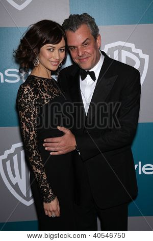 LOS ANGELES - JAN 15:  DANNY HUSTON & DATE arriving to Golden Globes 2012 After Party: WB / In Style  on January 15, 2012 in Beverly Hills, CA