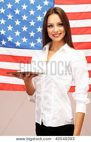 Young woman with American flag