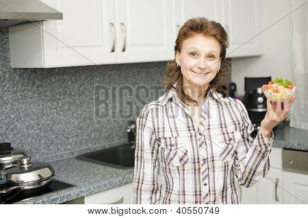 Woman Presenting A Cup With Salad