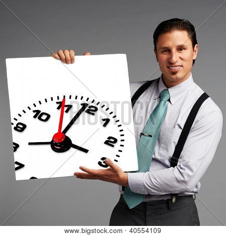 Business man holding white banner with clock: time / deadline concept