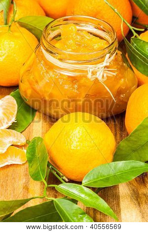 orange mandarin homemade jam in a glass jar
