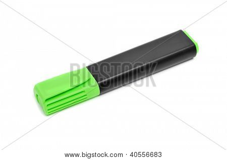 a green marker pen on a white background