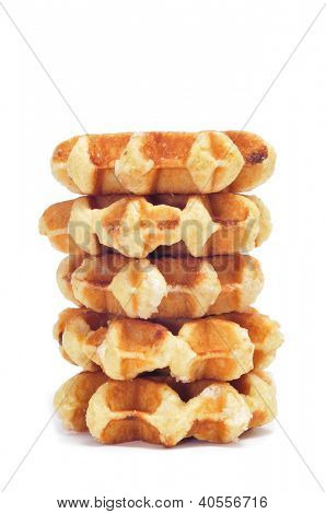 a pile of waffles on a white background