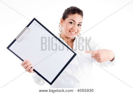 Portrait Of Doctor Pointing Notepad