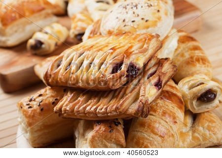 Puff pastry with sweet cream filling, selective focus