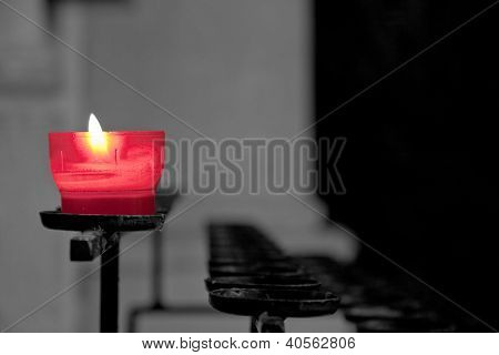 red candle with black and white background