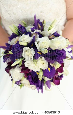 Bride Holding Bouquet with White Rose and Purple Flowers