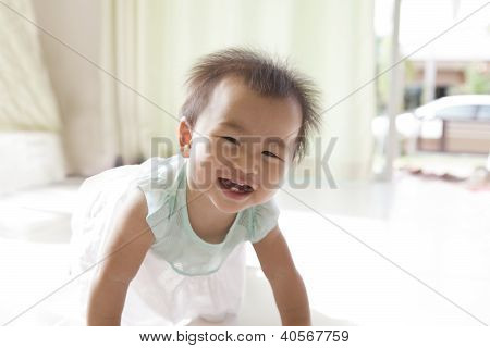 crawling of 10 month baby with funny face in home living room