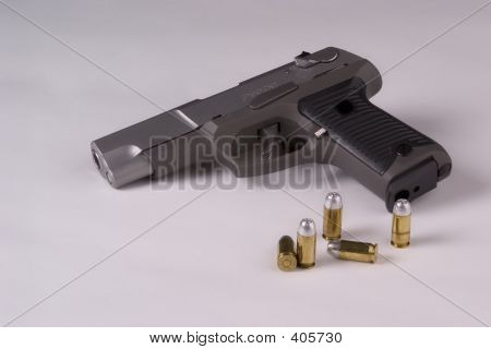 Handgun With Bullets