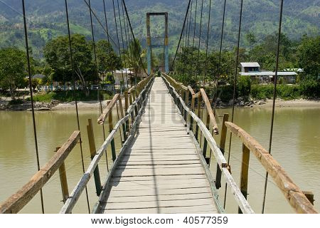 Old Suspension Bridge Accross A River