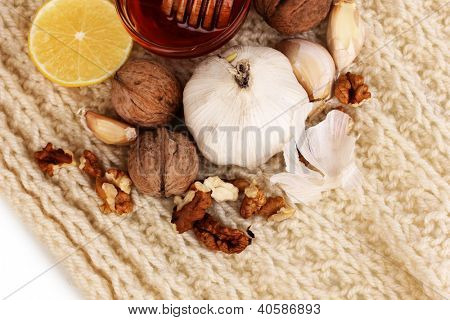 Healthy ingredients for strengthening immunity on warm scarf close-up