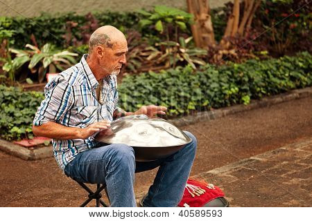 Street Musician Playing A Traditional Instrument Called Hang