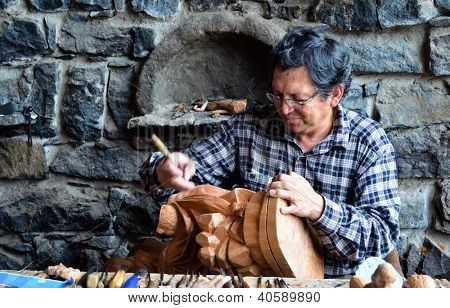 Woodcarver At Work