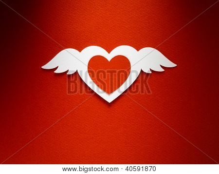 Valentine day heart with angel wings made of paper on red paper background
