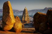 stock photo of karnataka  - the strange landscape of Hampi at sunset - JPG
