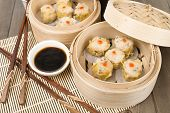 picture of siomai  - Siu Mai - Chinese steamed pork dumplings in bamboo steamers. Dim Sum