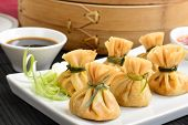 stock photo of thong  - Wonton - Oriental deep fried wontons filled with prawn and spring onion, served with dumpling and chili sauces.